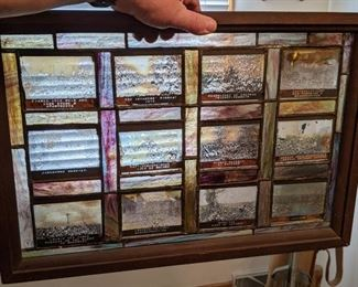 This is a leaded glass window pane with old photos on glass plates from France in the early 20th Century.  Firm at $100