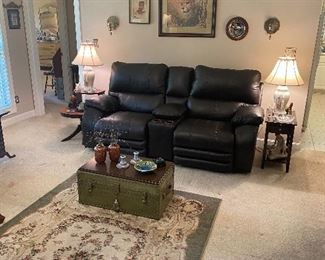 Less than a year old leather catnapper sofa recliner