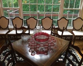 Gorgeous table and stately chairs.  The rug is a glamorous touch to any room!