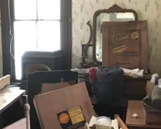 In the back there is an antique dresser. And to the left is an antique Victrola.  I am told they have the front grill for that Victrola. I hope to get a better photo if we can get near it