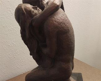Dark ceramic sculpture of man and woman in embrace, 70s-80s
