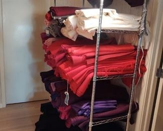 One of dozens of places in the house where we have collected bolts of fabric for you