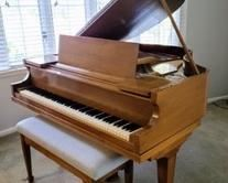 "Amazing Foster and Co. Baby Grand Piano. Absolutely beautiful piano! There is a few small scratches, but in otherwise excellent condition and was recently professionally tuned and dusted. The piano measures 56"" x 55"" and 36"" high"