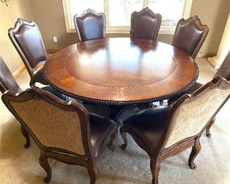 """Simply Stunning Round Dining Room Table w/ Eight Chairs. Imagine all the wonderful gatherings and dining experiences this beautiful table can offer! It is truly a beautiful table!   The table measures 75"""" in diameter and 31"""" H.   The chairs offer generous seating room boasting seat dimensions of 19"""" x 23"""" and are 46"""" h"""