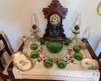 Working antique Waterbury clock, old oil lamss, antique green berry set