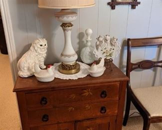 Antique Pine chest that has an oak top and is hand painted on front