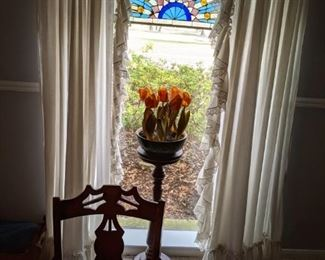 Another stained glass arched window paned