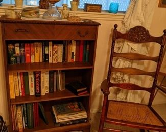 Old bookcase with top drawer....Antique Rocker with as is  cane seat