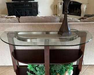 Streamlined Glass and  Two shelved wood Table that can an accent to any home decor