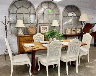Farm table Set of white cane back chairs 3 Cool domed windows with chains for hanging them Long dresser