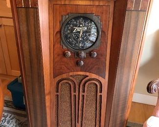 Antique Zenith console tube radio in working condition.