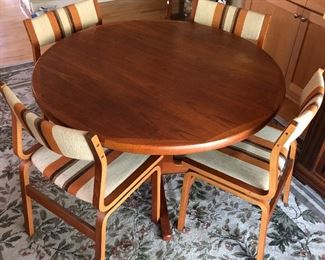 Mid-century modern dining table with four chairs.