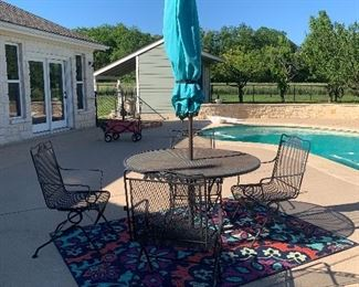 $350-  METAL PATIO TABLE WITH FOUR ROCKING PATIO CHAIRS