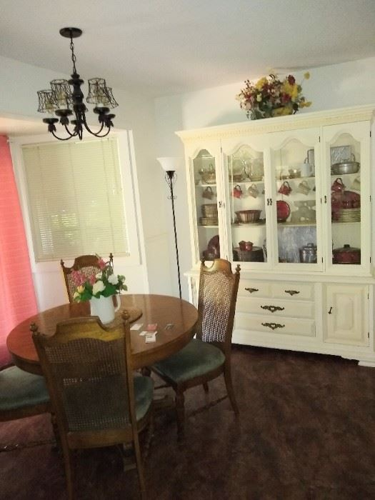 Cute dining table with leaves to expand and a white Hutch.