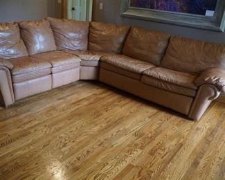 Leather curved hideabed sectional with ottoman
