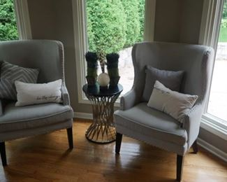 Modern sitting room chairs and spiral decorative colored tin end table