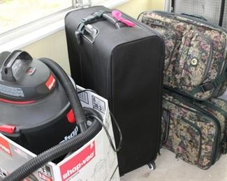 Luggage and like new shop vac