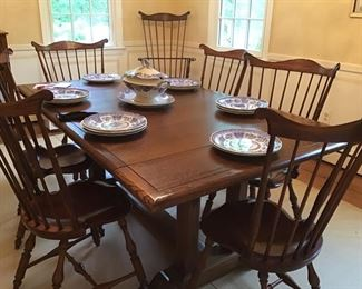 6 side chairs, D.R. DIMES and 2 armchairs., Oak trestle extension table with 2 additional leaves.