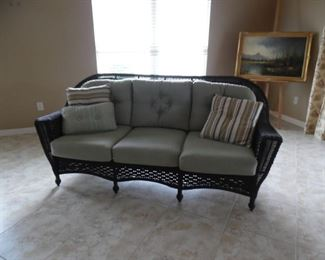 All weather wicker, 3 cushion sofa
