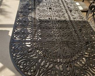 Very large metal lanai table and six chairs, very well built and heavy