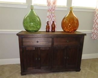Sideboard that matches Dining Table - Oversized Bottles by Ashley Furniture