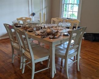 Large table with 6 chairs. Lots of silverplate. A couple of pieces of sterling.