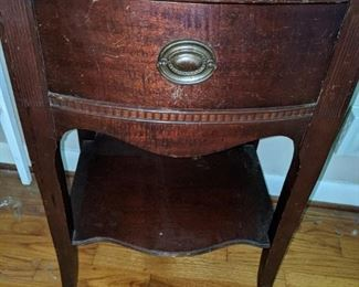 One of two mahogany nightstands