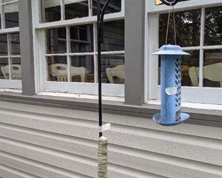 The bird feeder is metal