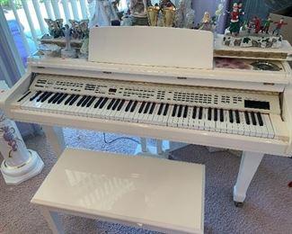 Kurzweil digital piano $1,000. White baby grand