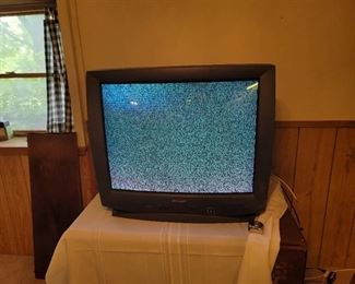 32 Sharp TV with Remote. Located in walkout basement.
