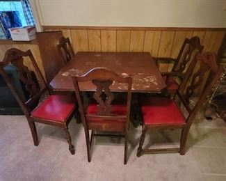 Vintage Drop Leaf Table with 1 Leaf and 5 Chairs. Located in Walkout basement.