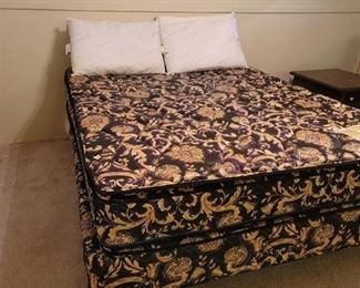 Sleeptronic Queen Size Bed with 4 Pillows. Located in walkout basement.