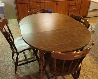 Table with 4 Chairs~ has 1 leaf in it. Located in Basement