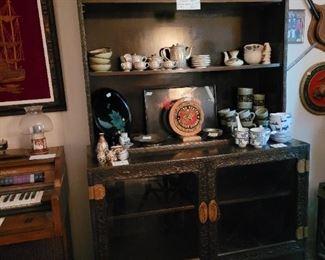 Vintage hand carved cabinet.