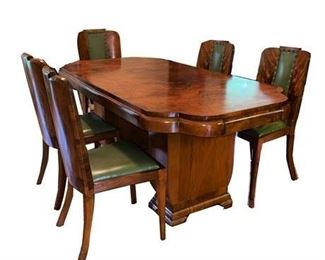 Lot 001 Art Deco Flame Mahogany Dining Table.   https://www.bidrustbelt.com/Event/LotDetails/120433870/Art-Deco-Flame-Mahogany-Dining-Table