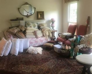 Linens, upholstered chairs, marble tables, hurricane lamp, mirror, oil painting, pillows and more