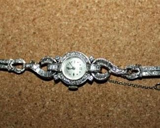 This is an Awesome Baume and Mercier Platinum and Diamond ladies watch.  The watch contains approximately 5 Total Carats of diamonds!