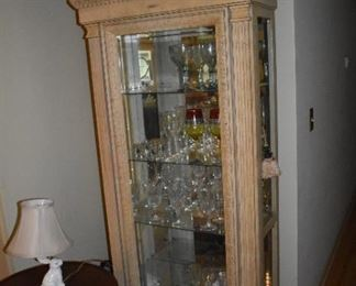 Lighted display case with side opening