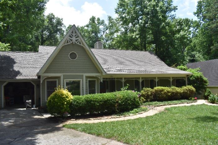 Magnificent Dunwoody home with lots of fine furnishings and accessories and plants, outdoor items and tools