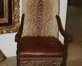 """no. 124 Pair of exotic game arm chairs - 48"""" tall - $995"""