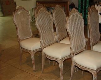no. 133 Set of eight French dining chairs leather seats/cane backs - $1650