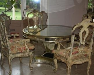 """no. 137 Round mirrored dining table 54"""" across - table has mirrored sides and top (top has a crack - priced as is) - $ 650 - Four arm chairs cane seats with cushions - $1,250"""