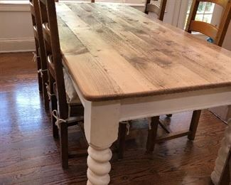 beautiful farmhouse table, white distressed base, natural wood plank top, 6 ladder back chairs with rush seats and thick white cushions - 2 arm, 4 side