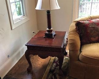 matching Carriage House carved side table