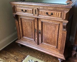 base of large antique glass front cabinet - great as a bar- next photo shows the top which attaches to this base