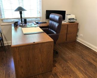 clean lined work from home Steelcase L desk with file cabinets and plenty of work space