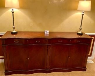 """Lot 7803. $1,575,00  Buffet/Credenza by Hurtado Furniture purchased at the High Point Marketplace in NC.  Hurtado is a high-end manufacturer that hand-crafts all their furniture in Valencia, Spain. This modern-traditional piece is a perfect example of form & function.  It has beautiful lines and is in excellent condition with  with a couple negligible scuffs.  21""""d x 36.5""""h x 80""""w. So many uses for this beautiful piece of furniture - can hold a ginormous flat screen tv, with audio and media items beneath, can house an army's worth of china and serving pieces, 21""""d x 36.5""""h x 80""""w, or anything else.  Homeowner paid $4,545 plus tax - yours for a fraction of this!"""