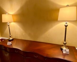 """Lot 7804. $80.00 Pair of buffet-style table lamps, in brushed nickel """"warm silver, almost gold """" finish.   Perfect for a Buffet or credenza - Could easily fit in to gold or silver accented decor. Rope-like body."""