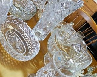 table full of Waterford, Swarovski & more crystal