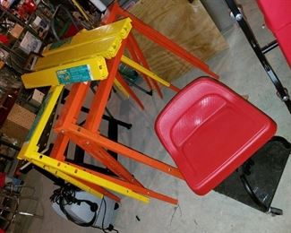 adjustable, collapsible, metal sawhorses.  7 of these, 5 never used